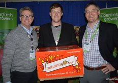 Dan Harrington, Tyler Weinbender and Jason Fonfara with Domex Superfresh Growers. Tyler proudly shows a box of Autumn Glory apples.