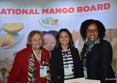 Smiles in the booth of the National Mango Board. From left to right: Cece Krumrine, Angela Serna and Valda Coryat.