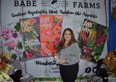 Rosie Munoz with Babe Farms proudly shows the company's finalist innovation award.