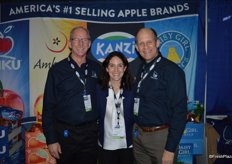 Tim Welsh, Danelle Huber and George Harter with CMI Orchards.