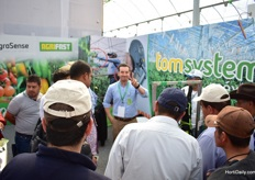 Juan Pablo Saucedo of AgroSense explaining the Tomsystem to a group of visitors.
