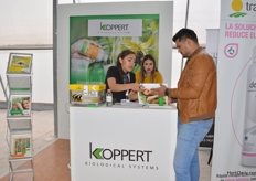 Giving information at the booth of Koppert in the Greenhouse.