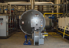 ... a burner system and boiler for converting gas from the biogas plant for heating the greenhouse...