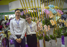 In the photo Robert WangMai le Thi with the dyed orchids.