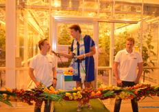 Two students, both sons of cucumber growers, opened the greenhouse.
