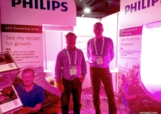 Andrew Olley and Aart Slobbe from Signify Australia standing under the bright pink LED lighting for use on a range of different crops.