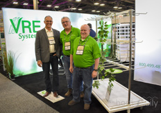David Eygenraam with VRE Systems is showing their drying racks and is visited by Butch Tomasko & Randy Shipley with VividGro.