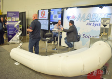 Dominic Paulhus with Mabre Canada explaining about their air systems to a client.
