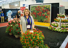 Melanie Fernandes with Syngenta Flowers shows the new Lantana. This sterile variety gets deeper red when it is exposed to sunlight.