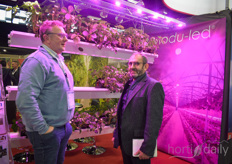 Marc Joulin with Modu-Led shows their LED solutions to a grower.