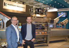 Leo van der Ven and Patrick ten Have of Koppert Machines. Behind them is the multipacker that is suitable for packaging various snack vegetables. The machines de-nest, weigh and lid and can be used for both plastic and cardboard.