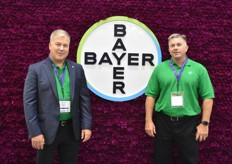 The Bayer team in front of their flower wall