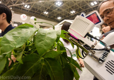 This robot is able to measure CO2 assimilation of the crop.