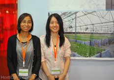Ms. Dawn Lee from Xin Sheng Group and her colleague. XinSheng is a turnkey greenhouse constructor.