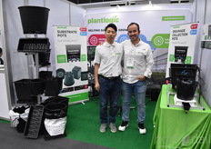 """Jonathan Camarena & Mike Sun with Plantlogic, showing their pots helping growers save water and fertilizer. ""That means saving money."""