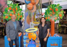 Michael Celani and Diana Salsa with Wonderful Citrus. The trees and tractor were offered as promotional displays to retailers during Wonderful's Halo season.