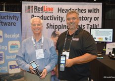 Todd Baggett and Greg Emery with RedLine Solutions proudly show the Zebra TC 8000 scanner and Zebra MC 3300 scanner.