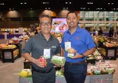 Kenny Kataoka and Fernando Sanchez with Melissa's show dragon fruit, organic grapes and an organic ready-to- drink coconut.