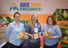Sara Pettit, Jodi Carkner and Kellie Starback with Awe Sum Organics show Zespri's organic SunGold kiwifruit. It comes in a 1 lb. clam shell as well as a 1 lb. pouch bag.