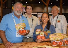 Jose Marrero, James Webster, Debbie Letourneau and Michael Ryshouwer with Flavorful Brands show Tasti-Lee tomatoes.