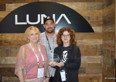 Peggy Hutson, Shane Lewis and Linzy Witherspoon with Luna. The company won the award for Best New Indoor Growing Technology with IUNU.