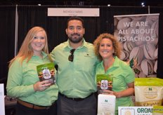 Shelbi Kautz, Rudy Placencia and Tristan Simpson with Nichols Farms show the company's Nic's Mix, a combination of pistachios and almonds.
