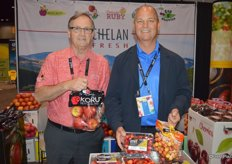 Stewart Lang and Mac Riggan with Chelan Fresh show Koru apples, as well as Orondo Ruby and Rainier cherries.